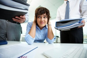 businesswoman-having-stress-in-the-office_1098-906