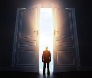 businessman in room with big open door