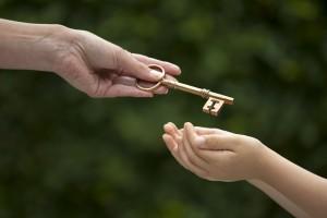 19154622 - mother handing key to daughter
