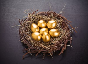 gold eggs in nest from hay on table